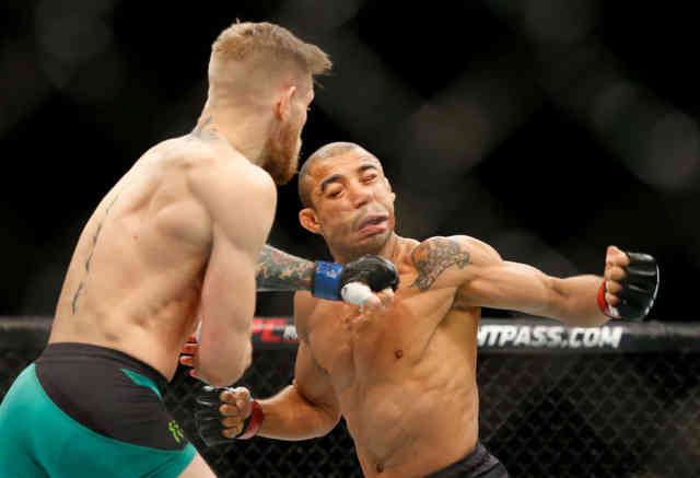 UFC 194 : Conor McGregor KOs Jose Aldo 13 seconds Images