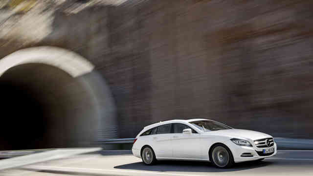 Mercedes Benz CLS 350 CDI white going high speed